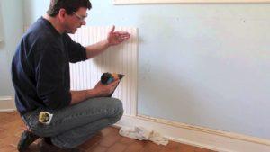 man installing bedboard